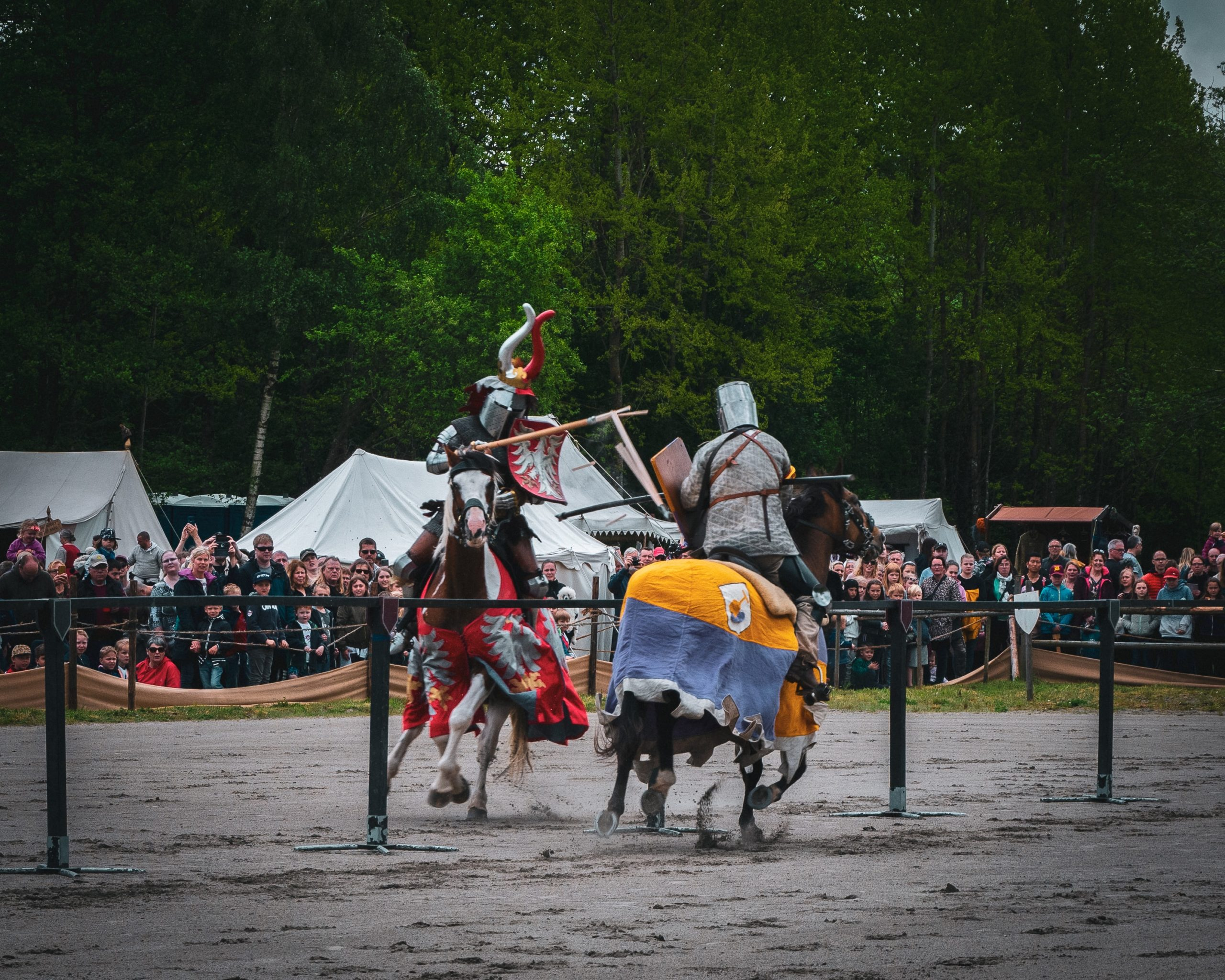 Two knights jousting on horses.