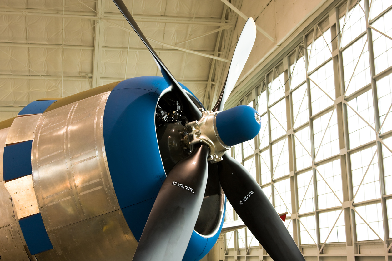 nose and propeller of an antique plane at an aviation museum
