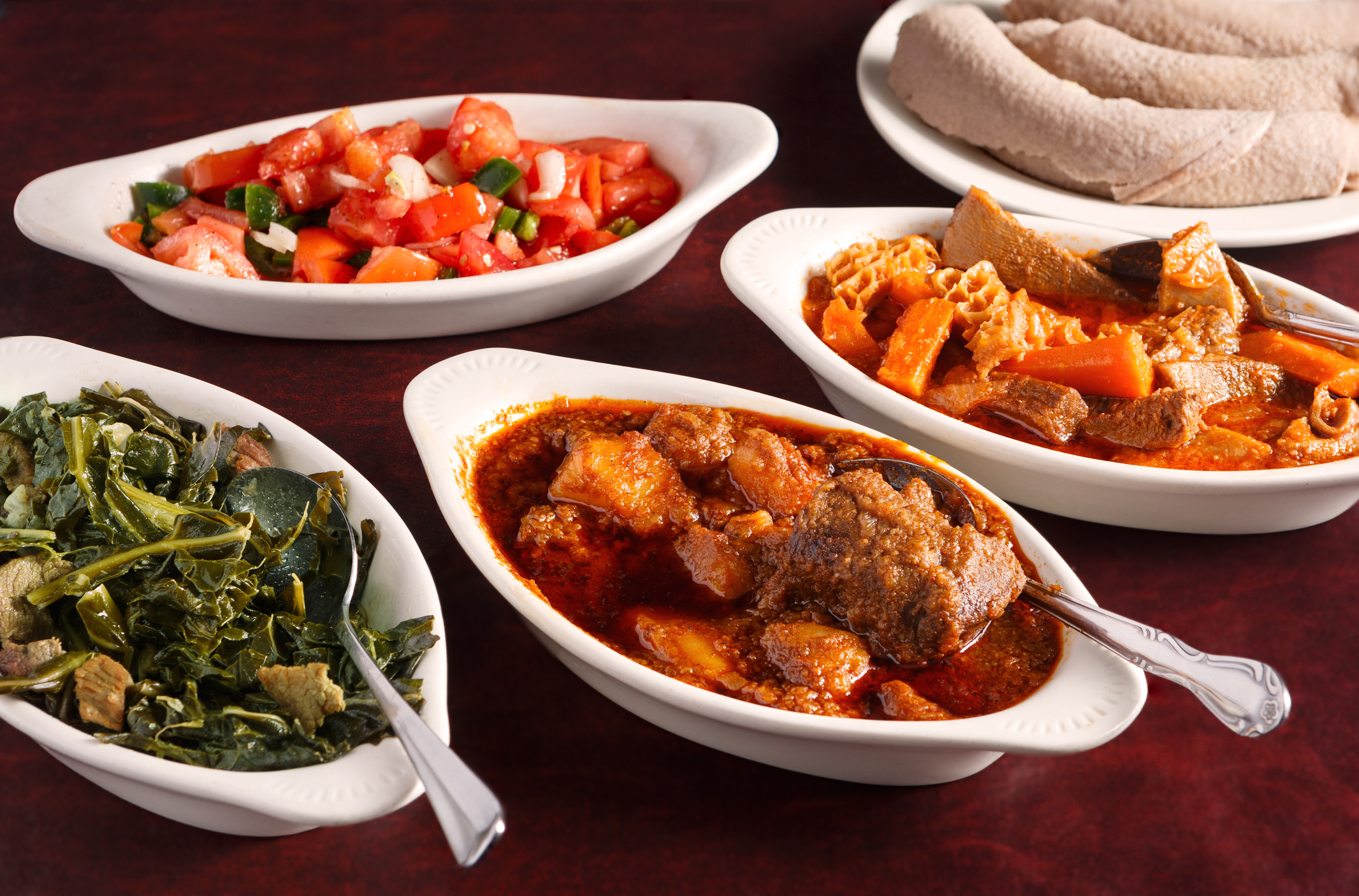 Variety of Ethiopian food dishes with injera