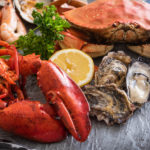 lobsters, oysters, and crab at a seafood market