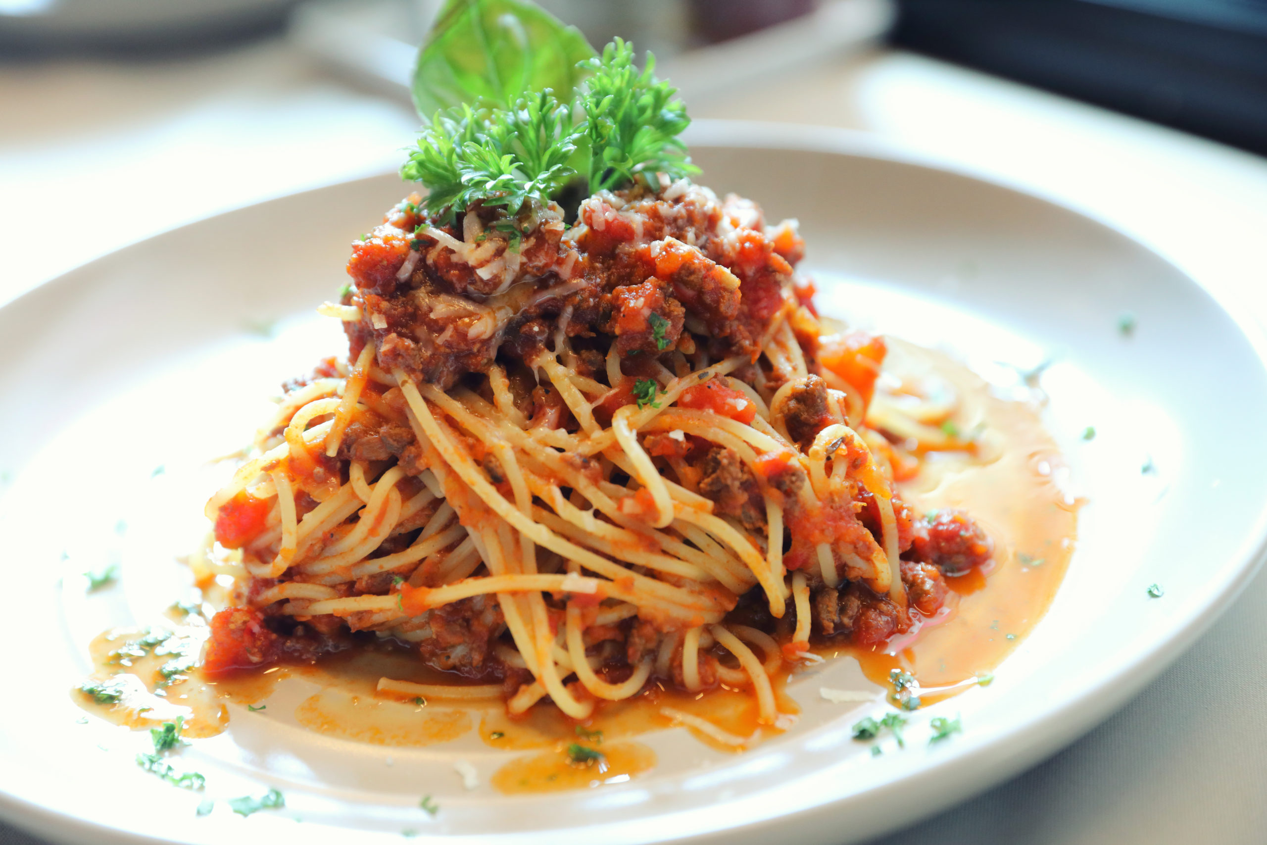 A plate of spaghetti with meat sauce.