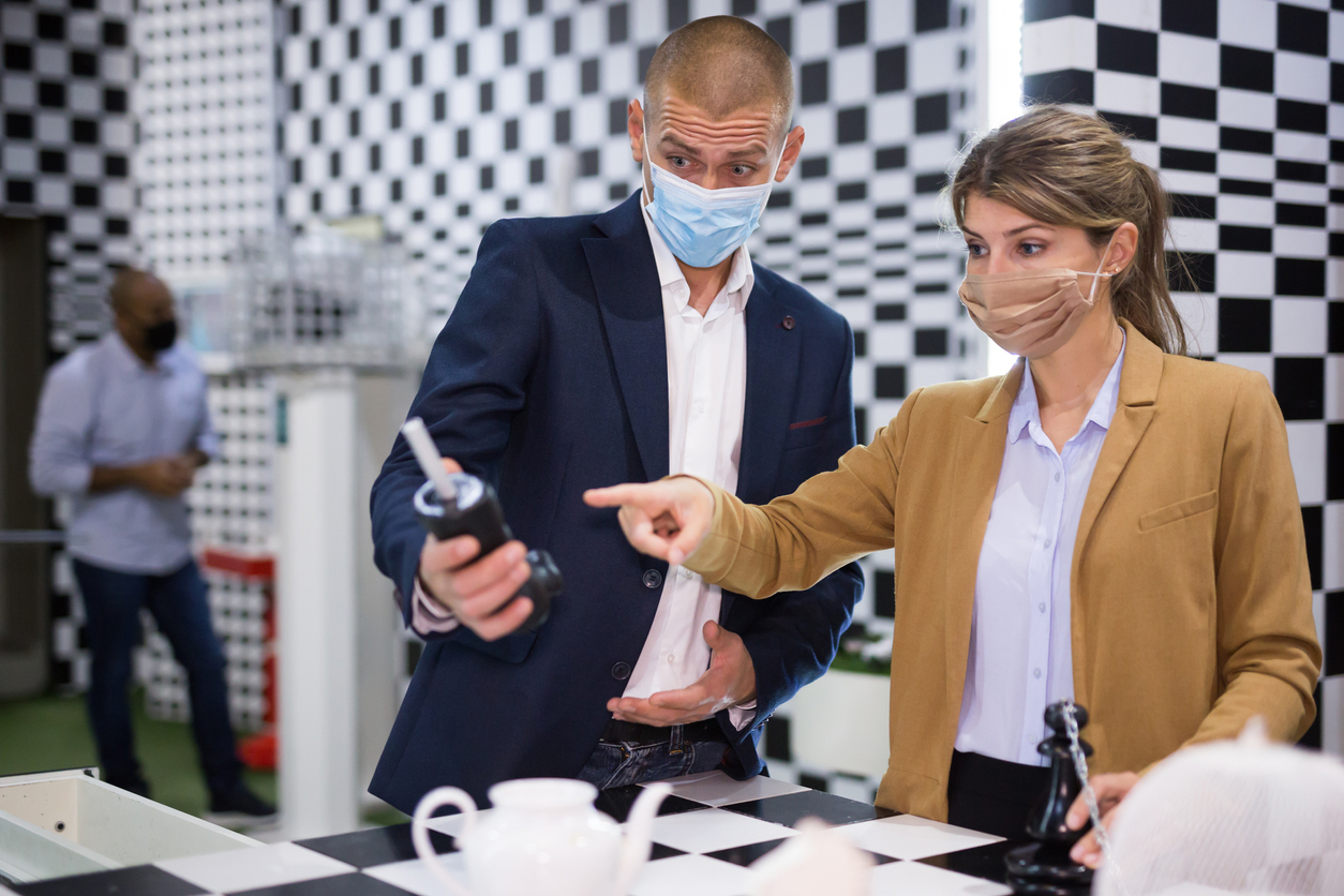 Two people discussing a clue in an escape room | escape rooms near Jessup